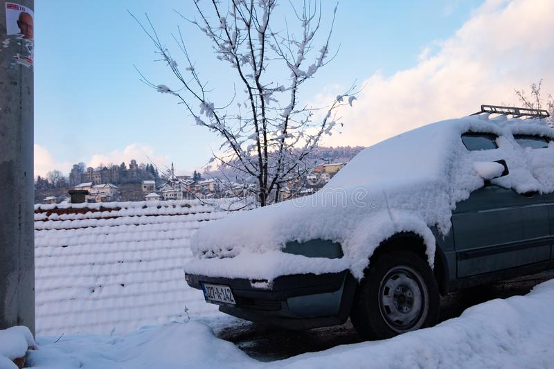 Parked Car Covered by Snow stock images