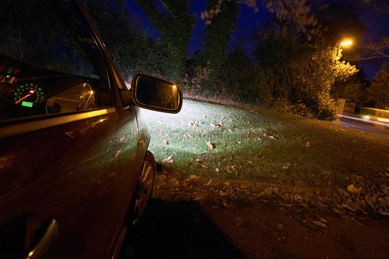 Parked Car. On a dark street at night royalty free stock photos