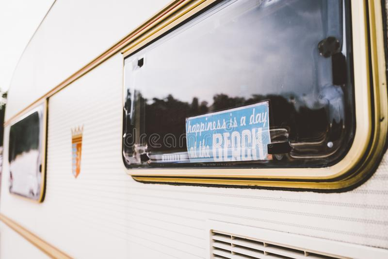 Parked caravan trailer window stock image