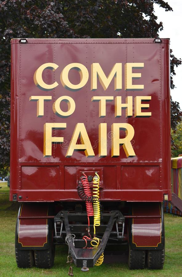 `Come to the Fair` on the back of a carnival vehicle. A parked carnival trailer with `Come to the Fair` in lettering on the back royalty free stock image