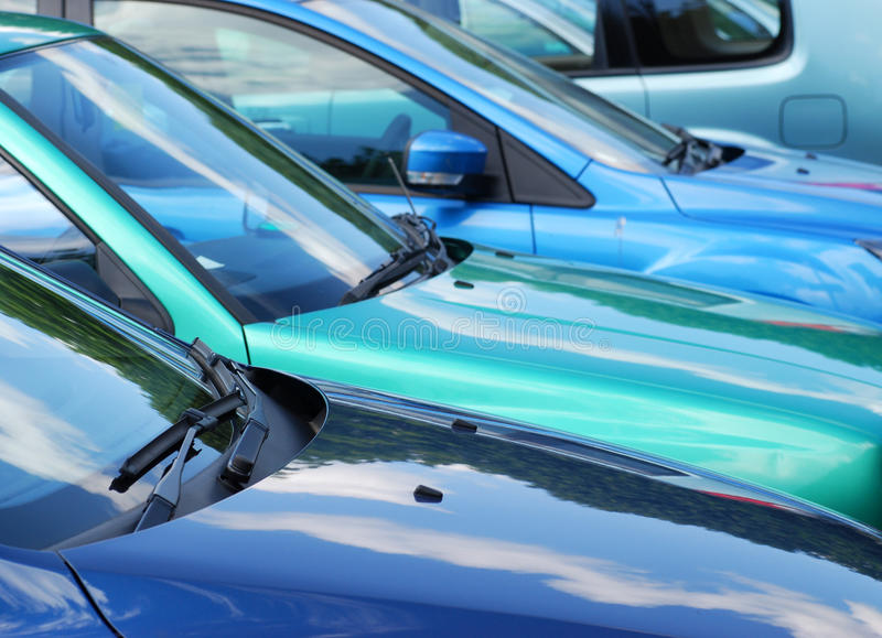 Parked cars. Telephoto view of row of parked vehicles in car park royalty free stock photos