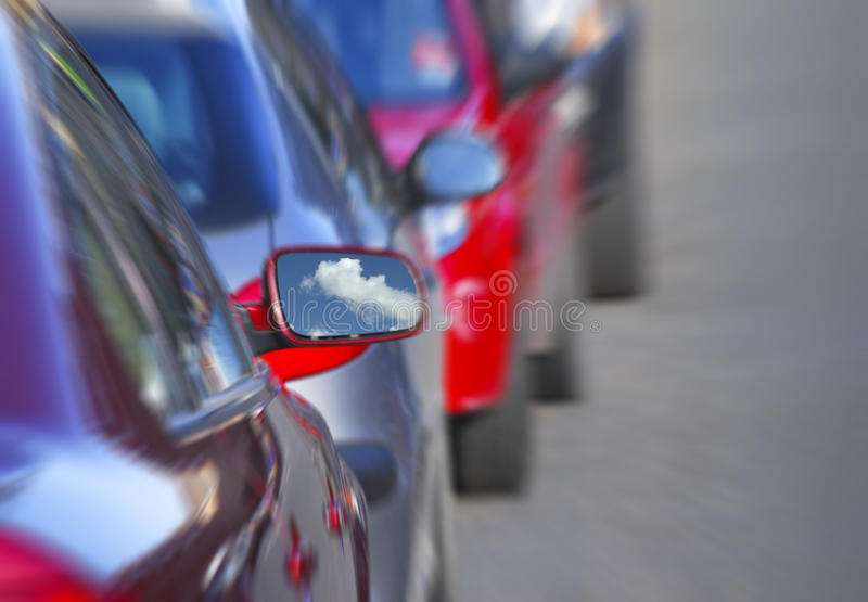 Parked cars. Zoom effect applied to cars parked in road stock images