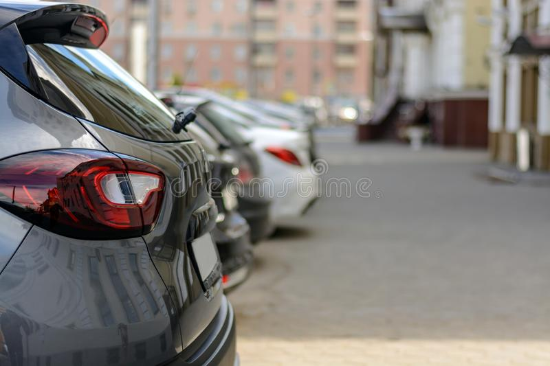 Parked cars along the sidewalk, side view stock image