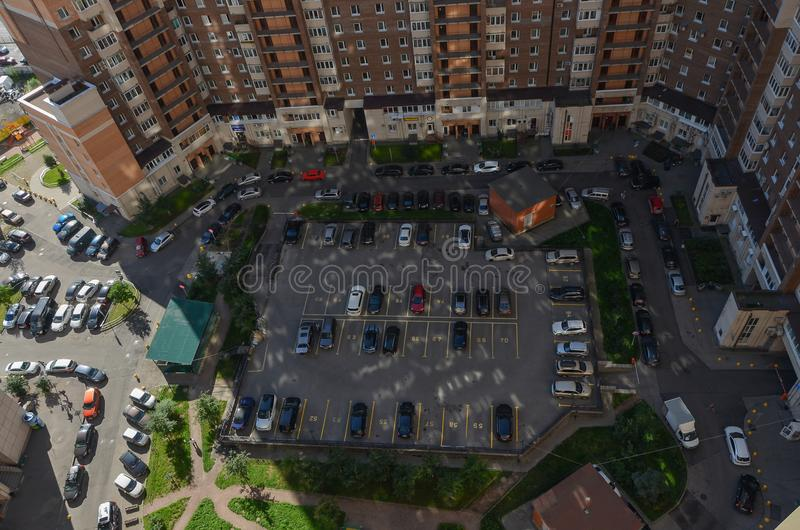 Parked cars in the courtyard of a block of flats in a new district of St. Petersburg. view from above. The view from the top stock photography