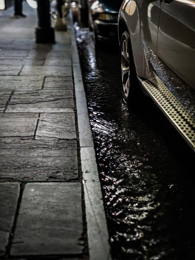 Parked cars in flooded street royalty free stock photography