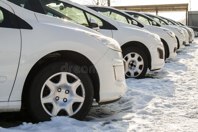 Parked Cars on a Lot. Row of New Cars on the Car Dealer Parking. Lot. Cars for Sale Market Theme royalty free stock images