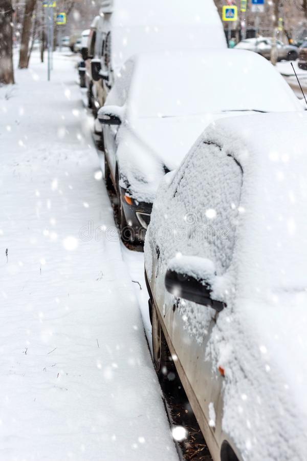 The parked cars in snow. Winter urban scene stock photo