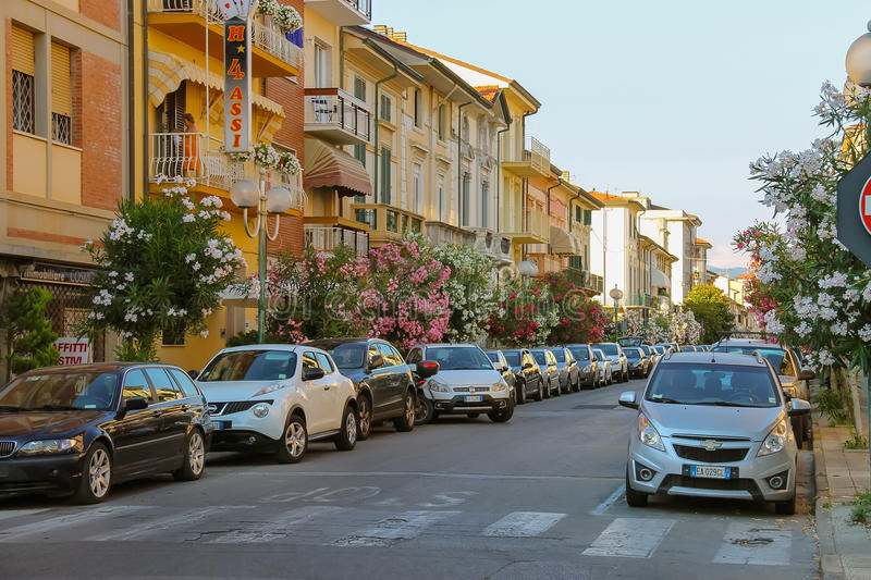 Parked cars on the street in Viareggio, Italy. Viareggio, Italy - June 28, 2015: Parked cars on the street in city centre. Viareggio is the famous resort on the stock images