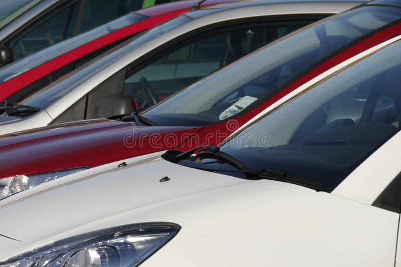 Parked cars. Telephoto view of cars parked in city centre stock images