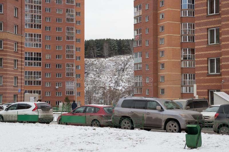 Parked cars in the yard between the residential buildings of the city of Novosibirsk in the winter. Novosibirsk Region. Russia stock photography
