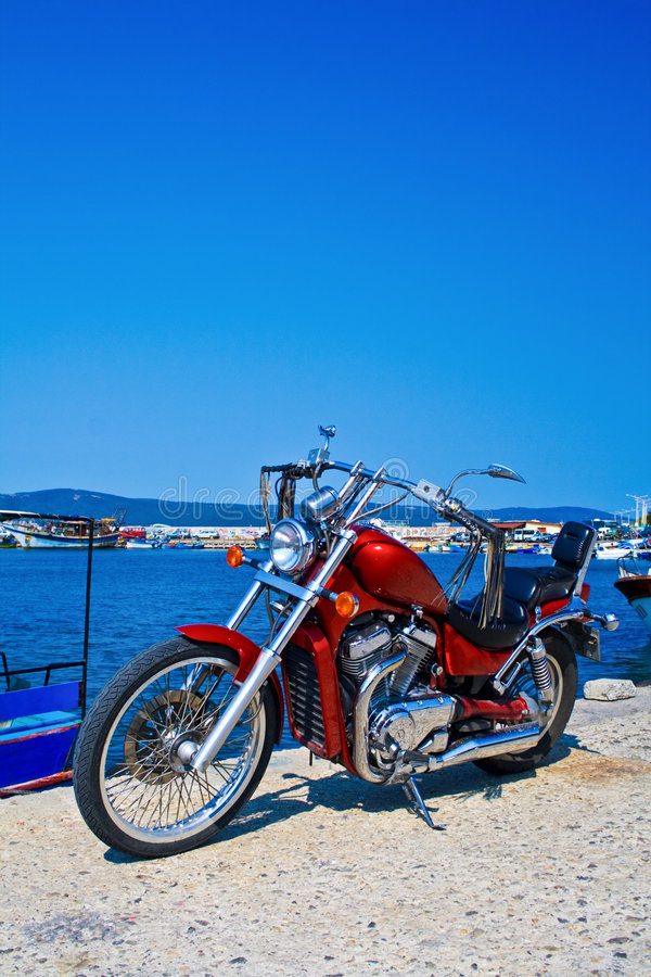 Parked chopper motorcycle outdoors. Parked chopper motorcycle and blue sky royalty free stock images