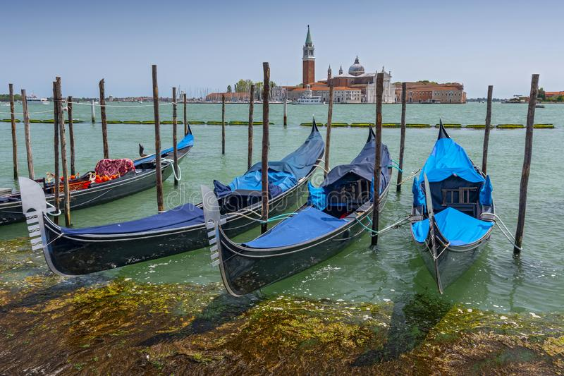 Parked gondolas and the Church of San Giorgio Maggiore in Veneto, Venice, Italy stock image