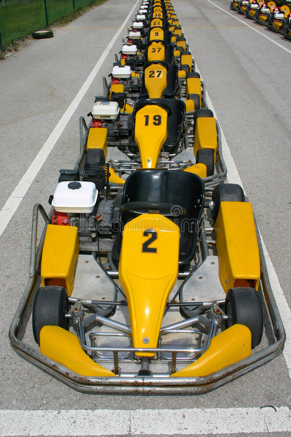 Parked karts. Parked row of karts waiting for a race royalty free stock photo