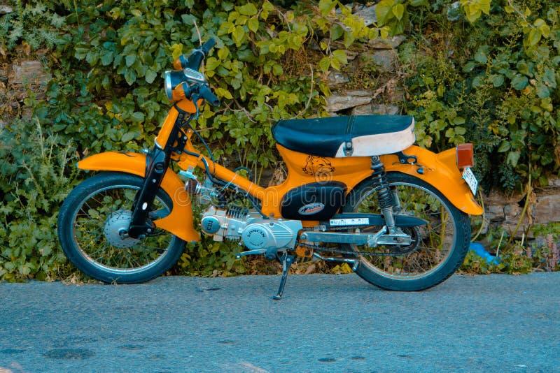 Parked Orange Motorcycle royalty free stock photo