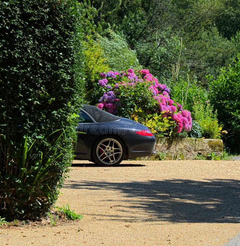 Parked Porche sports car. Parked Classic Porche sports car with a damaged sunroof in English Country stock photo