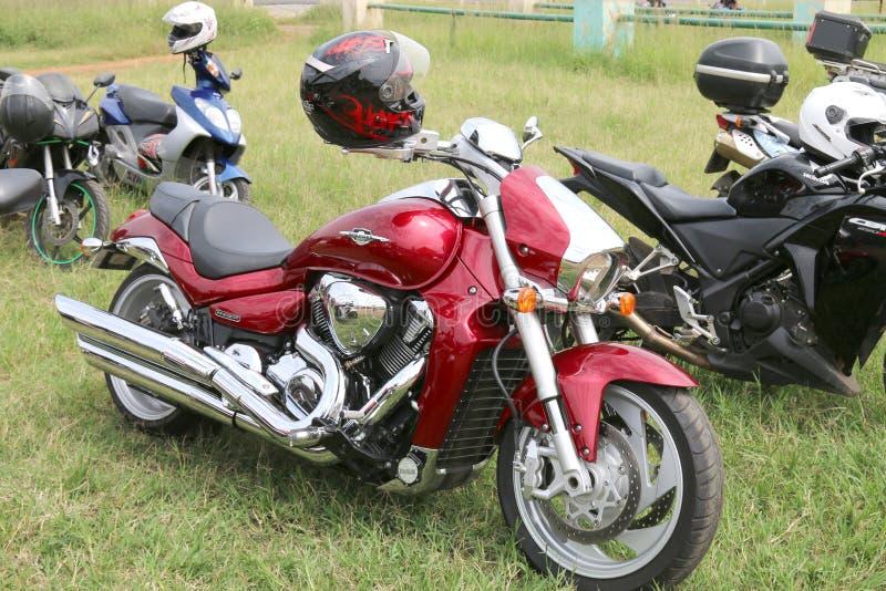 Parked red Suzuki Boulevard M109R motorbike on green grass. Rustenburg, South Africa - March 3, 2017: Parked red Suzuki Boulevard M109R motorbike on green grass stock photos