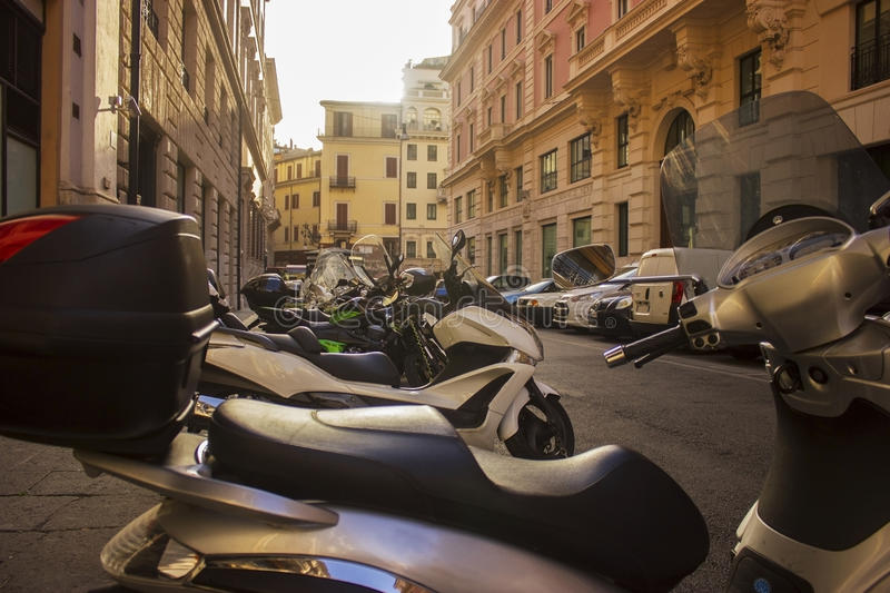 Parked scooters on the streets of Rome. A popular mode of transportation stock images
