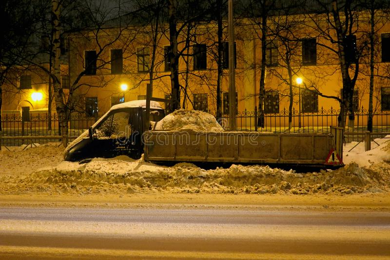 Parked car on the roadside swept by snow royalty free stock photos