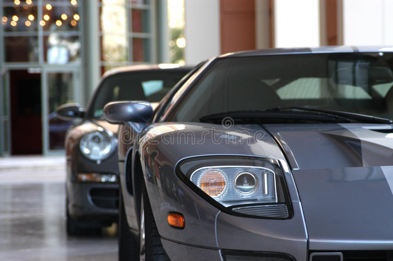 Parked Sports Cars. Sports cars parked in front of a hotel royalty free stock photos