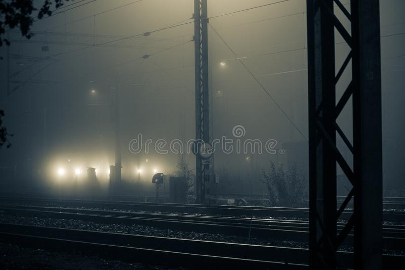 Parked Train at Foggy Midnight. Multiple train parked on railway at misty midnight - Southern Finland stock photos