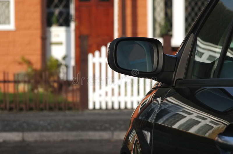 Parked vehicle. Closeup of a parked vehicle outside a home stock images