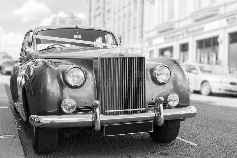 Parked vintage wedding car royalty free stock photography