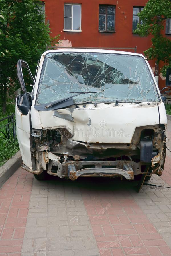 Parked white minibus after an accident stock images