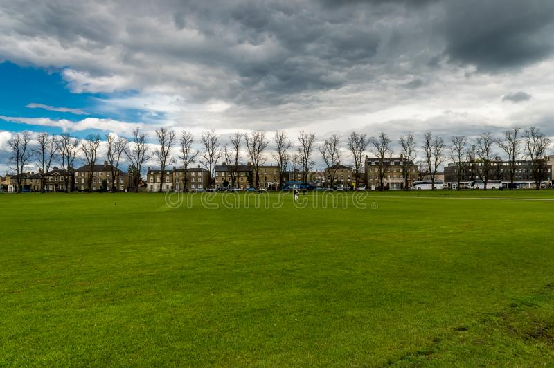 Parker`s piece is large park in Cambridge, Cambridgeshire, England, United Kingdom. Under the evening sky with clouds royalty free stock images