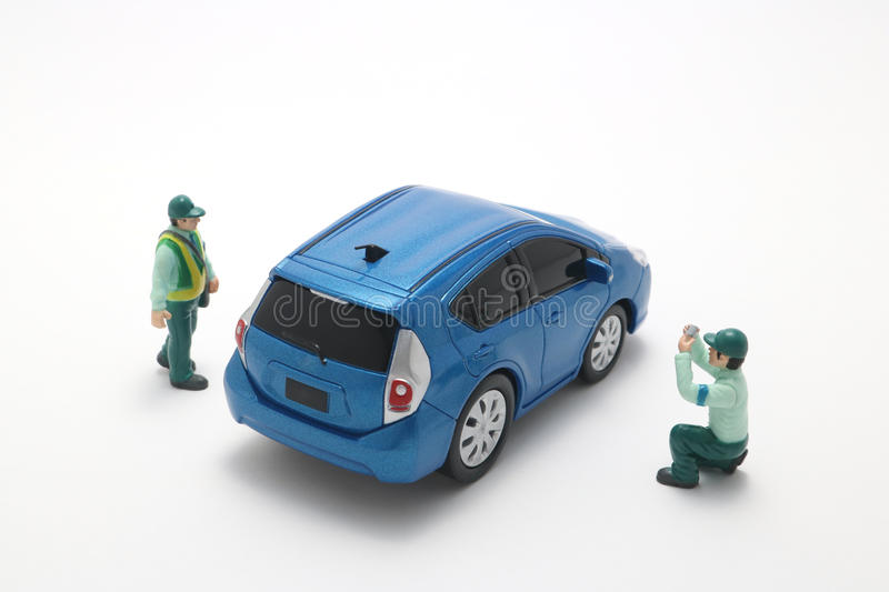 Parking ban crackdown. Male police officers to crack down on car parking violation stock image