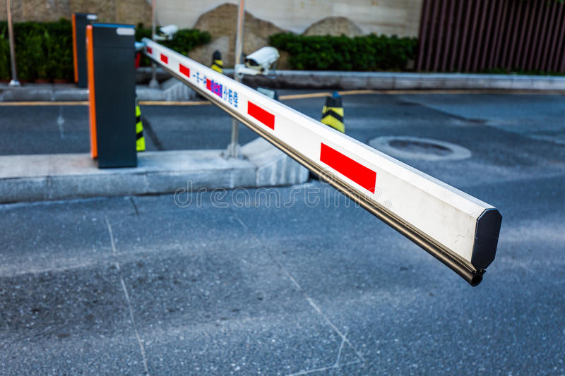Parking barriers. Some parking lot gates - exit and entrance in red and white royalty free stock photography