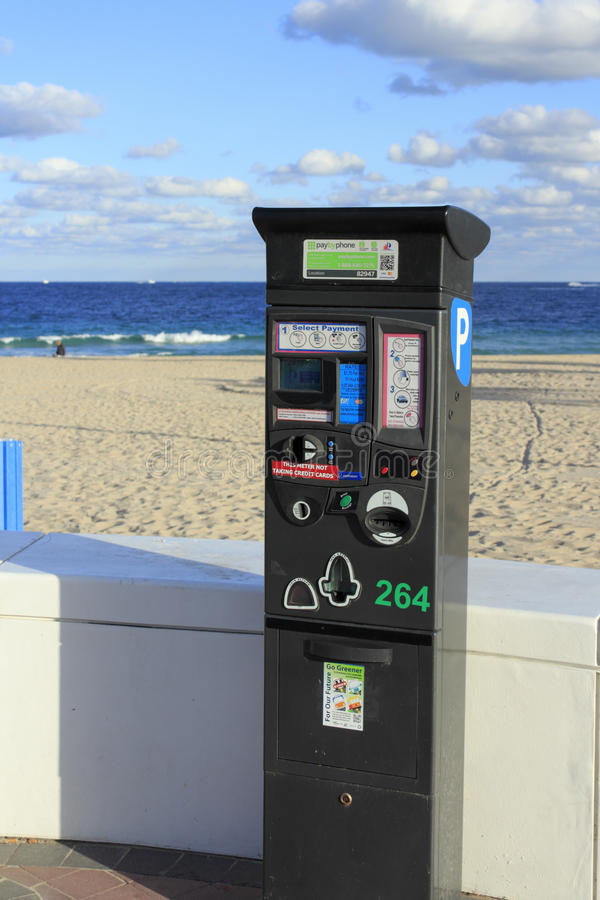 Parking at the Beach. FORT LAUDERDALE, FLORIDA - JANUARY 23, 2014: Electronic parking machine that has a variety payment options, located in front of a white stock images
