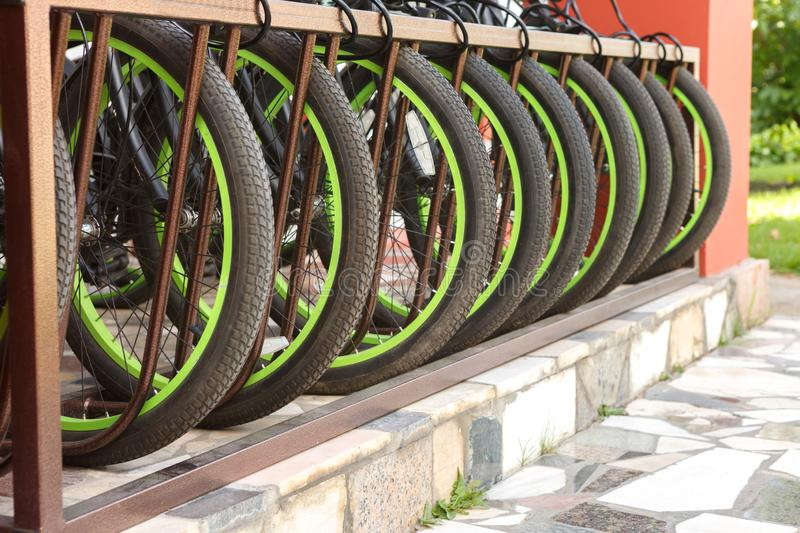 Parking for Bicycle wheel closeup. Parking for Bicycle wheels close-up. A lot of Bicycle wheels, Europe stock photography