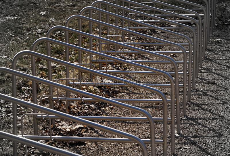 Parking for bicycles near park. stand rhythms. Grey backrround. royalty free stock photography