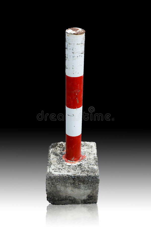 Parking blockage device in red and white. Parking blockage device made by steel and concrete in red and white stock photo