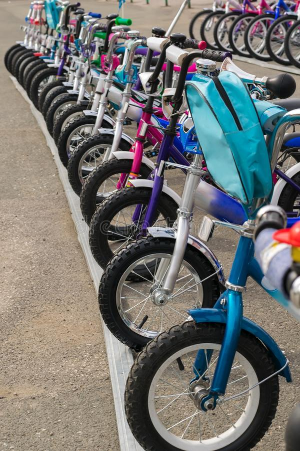 Parking of brand new bicycles on the asphalt royalty free stock images