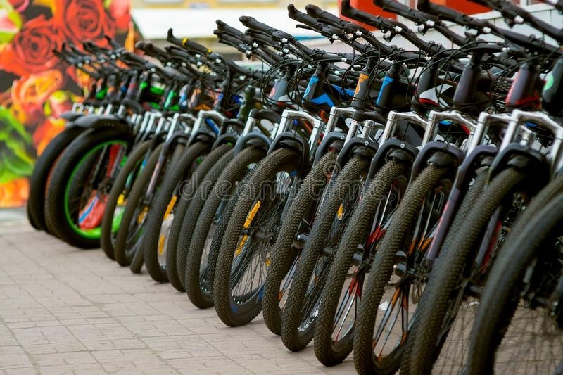 Parking of brand new teenager bicycles on sale royalty free stock image