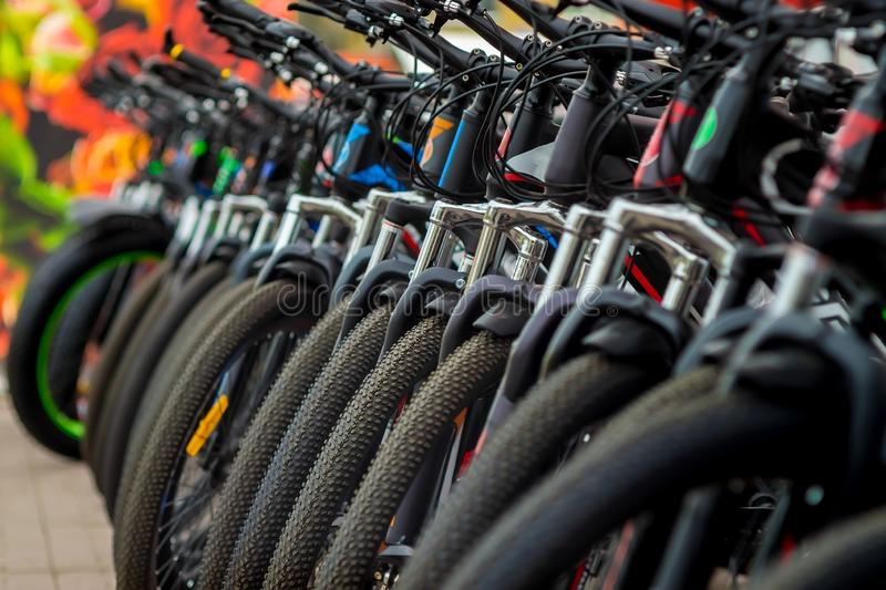 Parking of brand new teenager`s bicycles on asphalt, sale royalty free stock photography