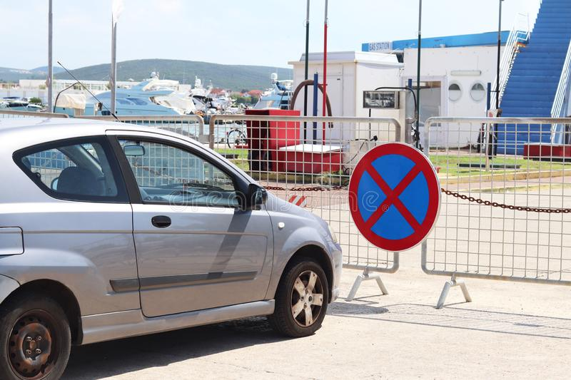 Parking a car in a prohibited place. Road signs and markings. Evacuation of the vehicle. Violation of the rules of the road. Ban. Stop and block the passage royalty free stock image