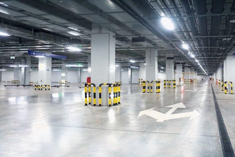 Parking garage - interior shot of multi-story car park. Underground empty  parking royalty free stock photos