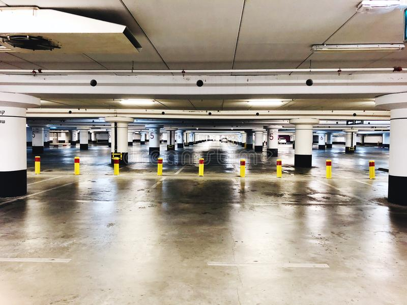 Parking garage underground interior, neon lights in dark industrial building, modern public construction. stock photography