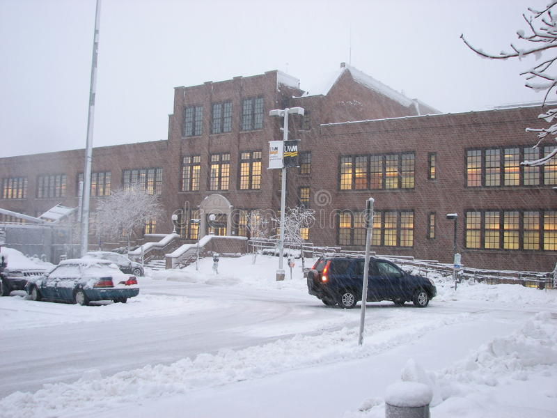 Parking lot and Admin building in heavy Snow Storm. Parking lot and Administrative building in heavy Snow Storm UWM (University of Wisconsin-Milwaukee) royalty free stock images