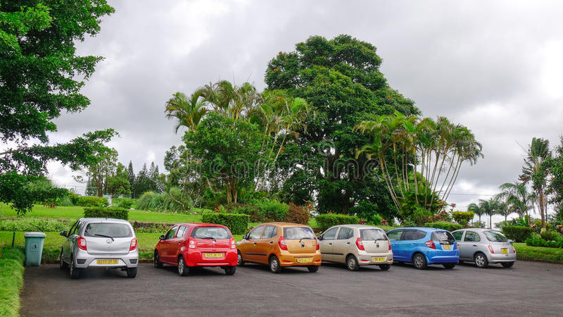 Parking lot at the botanic garden in Mauritius. Highlands, Mauritius - Jan 8, 2017. Parking lot at the botanic garden in Highlands, Mauritius. Mauritius received stock photo