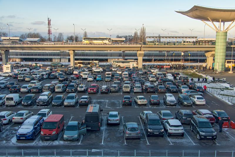 Parking lot is full of cars at The Boryspil airport stock photography