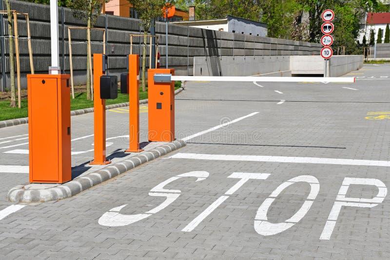Parking lot gate and stop sign stock photos
