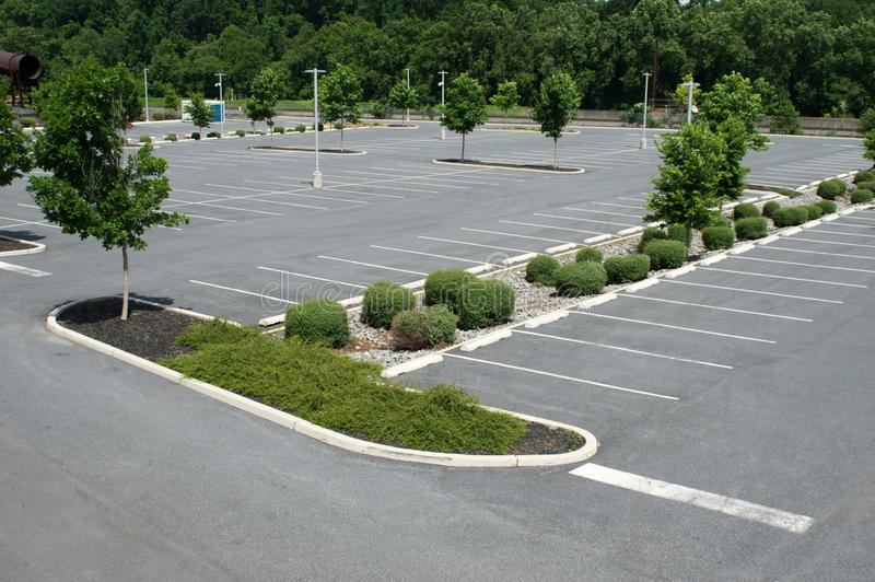 Parking Lot for Vehicles. A Parking Lot for Vehicles with all the lines, shrubs, trees and lights stock images