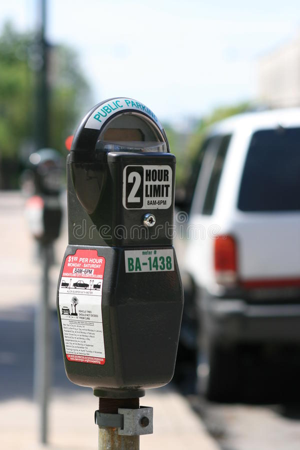 Free Parking Meter Against Blurred Car Royalty Free Stock Photo - 10813255