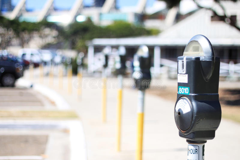 Parking Meter DOF. Shallow DOF shot of a row of coin operated self service parking meter stock images