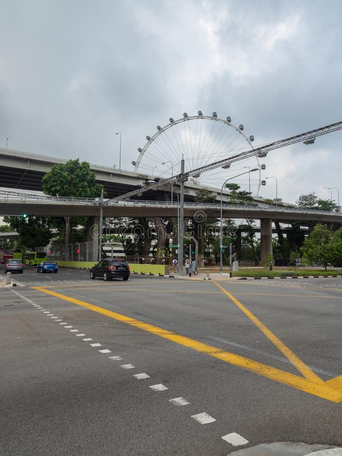 The parking outside Singapore Flyer, Singapore. Singapore - August 20 2018: The Singapore Flyer is a giant Ferris wheel which opened in 2008 royalty free stock photography