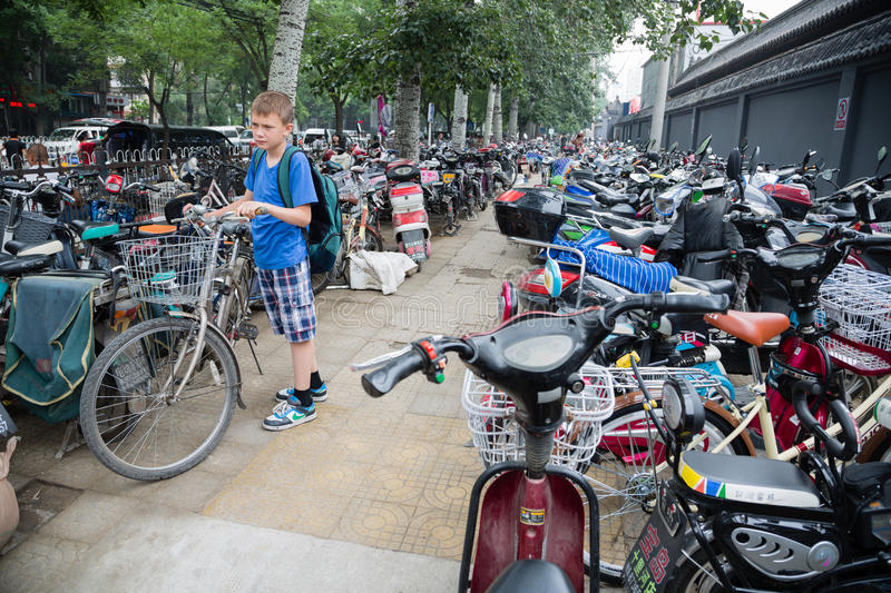 Parking scooters and bicycles in Beijing. BEIJING - CIRCA JUNE, 2015: Parking scooters, motorcycles and bicycles in the center of Beijing. These kinds of royalty free stock photos