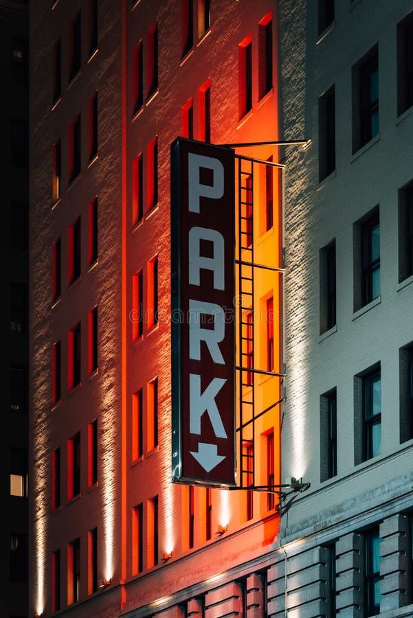 Parking sign at night, in Midtown Manhattan, New York City.  stock photo